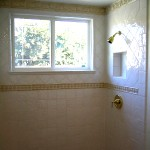 window and niche in shower remodeling project