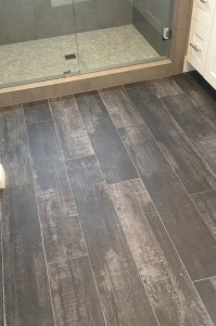 Orange County bathroom designers use faux wood ceramic tile to give warmth to bathrooms