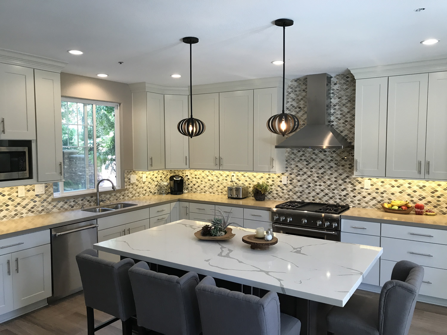 Mixing Dark Stained And Light Painted Finishes On The Cabinetry, Unique  Quartz Colors, Mosaic Backsplash And Rich Woodlook Porcelain Tile Floors A  Space Was ...