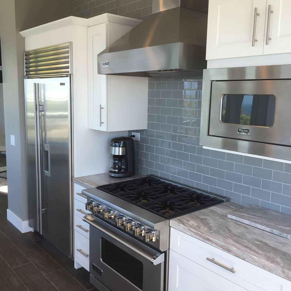 Gray Glazed Subway Tile Used For Backsplash In This Kitchen Remodel